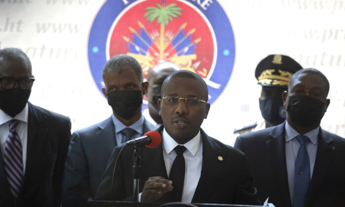 Haiti's interim Prime Minister Claude Joseph gives a press conference in Port-au-Prince, on Friday, July 16, 2021. (AP Photo/Joseph Odelyn)