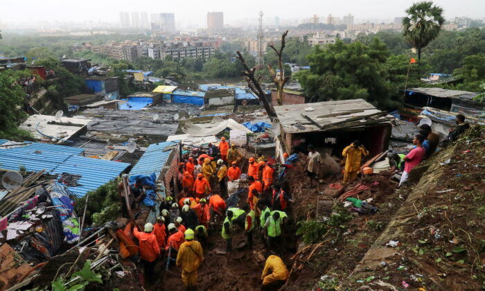 Rescue workers search for survivors after a residential house collapsed due to landslide caused by heavy rainfall in Mumbai, India, July 18, 2021. (REUTERS/Niharika Kulkarni)