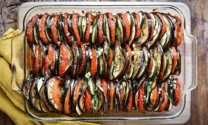 The classic summer vegetable tian is made with layered slices of tomato, zucchini, and eggplant, slow-roasted with olive oil and herbs until meltingly tender. (Audrey Le Goff)