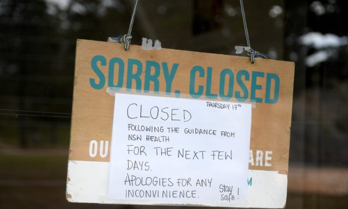 A closed sign is seen on a business at Newport beach, in Sydney, Australia on Dec. 18, 2020. (AAP Image/Dan Himbrechts)