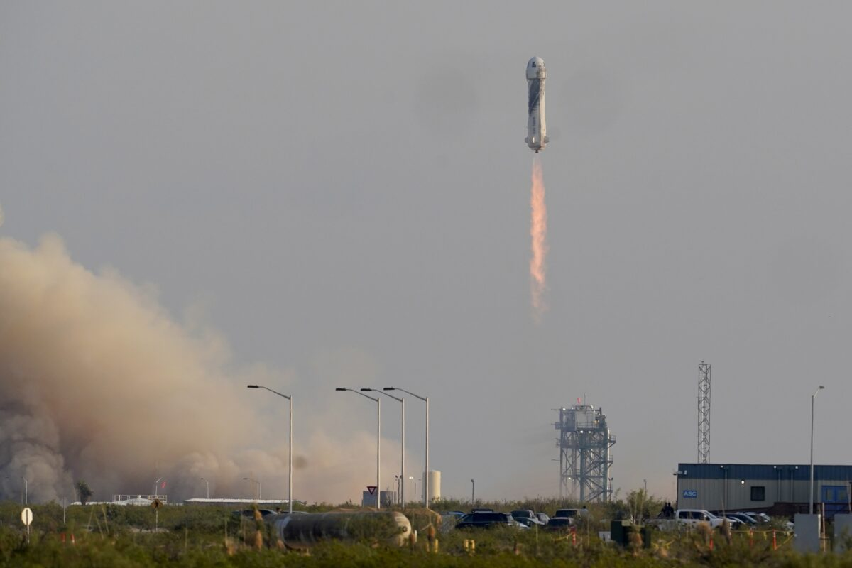 Blue Origin's Bezos Reaches Space on First Passenger Flight