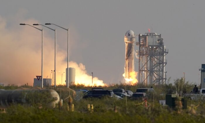 Blue Origin's New Shepard rocket launches carrying passengers Jeff Bezos, founder of Amazon and space tourism company Blue Origin, brother Mark Bezos, Oliver Daemen and Wally Funk, from its spaceport near Van Horn, Texas, on July 20, 2021. (Tony Gutierrez/AP Photo)
