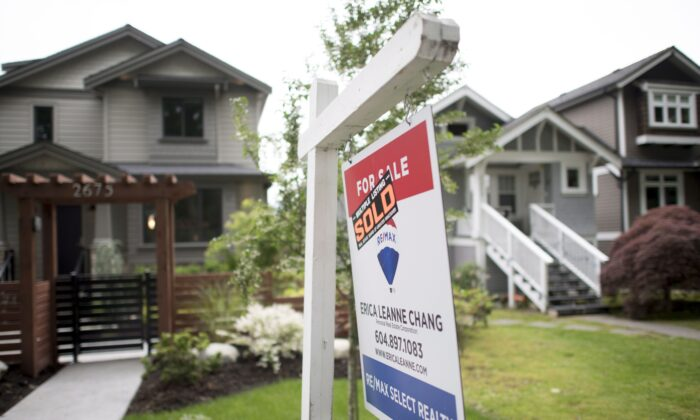 A real estate sign outside a home in Vancouver on June 12, 2018. (The Canadian Press/Jonathan Hayward)