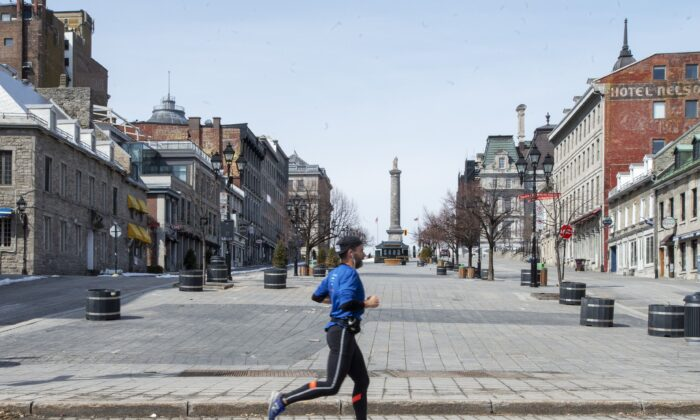A man jogs through an empty Place Jacques Cartier in Montreal on March 25, 2020, as the COVID-19 pandemic began to take hold in Canada. (The Canadian Press/Ryan Remiorz)