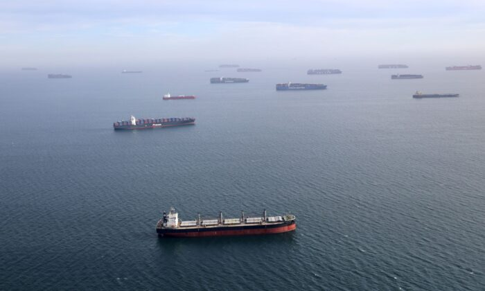 Container ships and oil tankers wait in the ocean outside the Port of Long Beach-Port of Los Angeles complex, amid the coronavirus disease pandemic, in Los Angeles, Calif., on April 7, 2021. (Lucy Nicholson/File/Reuters)
