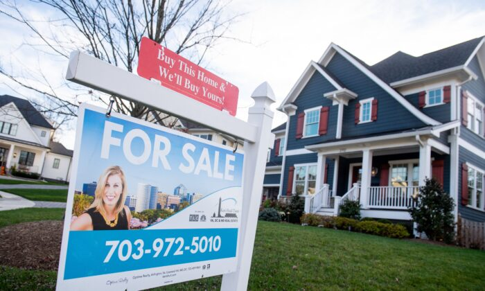 A house's real estate for sale sign is seen in front of a home in Arlington, Va., on Nov. 19, 2020. (SAUL LOEB/AFP via Getty Images)
