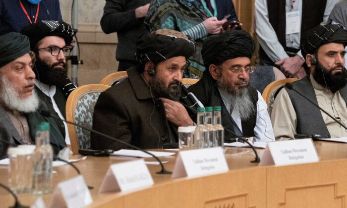 Mullah Abdul Ghani Baradar, Taliban's deputy leader and negotiator, and other delegation members attend the Afghan peace conference in Moscow, Russia, on March 18, 2021. (Alexander Zemlianichenko/Pool via Reuters)