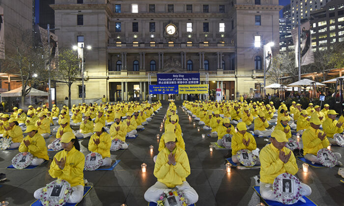 Falun Dafa practitioners commemorate lives lost and 20 years of persecution by the Chinese communist regime in Sydney, Australia, on July 19, 2019. (The Epoch Times)