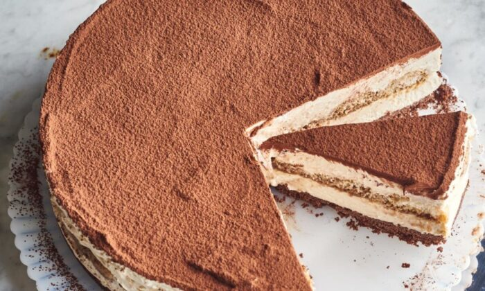 The layer of coffee-soaked ladyfingers is a lovely surprise inside the center of the cake. (Joe Lingeman/TNS)