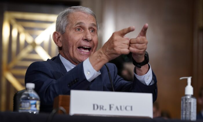 Dr. Anthony Fauci, the head of the National Institute of Allergy and Infectious Diseases, responds to Sen. Rand Paul (R-Ky.) during a congressional hearing in Washington on June 20, 2021. (J. Scott Applewhite/Pool/Getty Images)