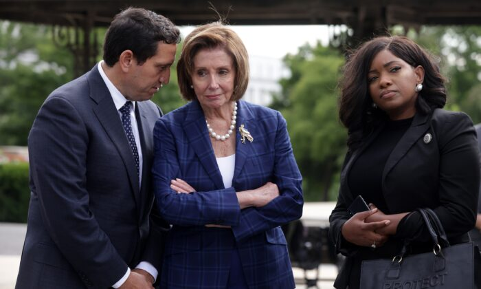 Texas Rep. Trey Martinez Fischer, one of the five Texas House Democrats who have tested positive for COVID-19, is seen on Capitol Hill with House Speaker Nancy Pelosi (D-Calif.) (C) in Washington, on July 13, 2021. (Alex Wong/Getty Images)