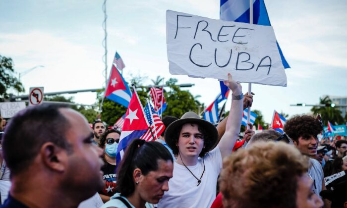 """A man holds a """"Free Cuba"""" sign during a Freedom Rally showing support for Cubans demonstrating against their government, at Freedom Tower in Miami, Fla., on July 17, 2021. (Eva Marie Utzcategui/AFP via Getty Images)"""