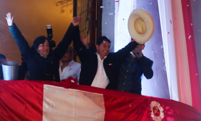 """Leftist Pedro Castillo celebrates from the headquarters of the """"Free Peru"""" party after Peru's electoral authority announced him as the winner of the presidential election, in Lima, Peru, on July 19, 2021. (Sebastian Castaneda/Reuters)"""
