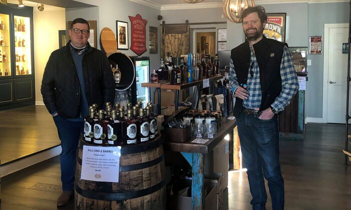 Justin Sloan (L) and Justin Thompson of Lexington's House of Bourbon own the state's largest bourbon store. (Salena Zito)