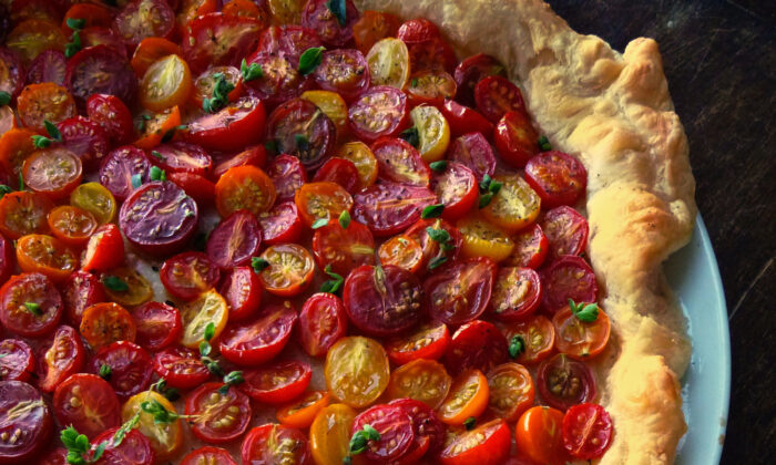 This unpretentious tart gives the sweet and juicy tomatoes center stage. (Lynda Balslev for Tastefood)
