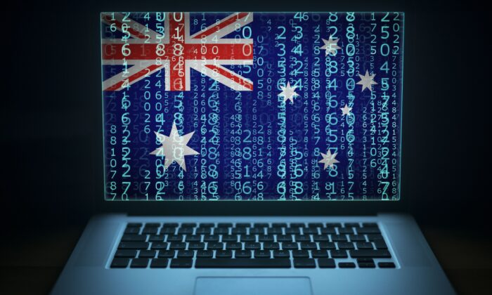 Laptop with binary code and Australia flag on the screen. (littlewolf1989/AdobeStock)