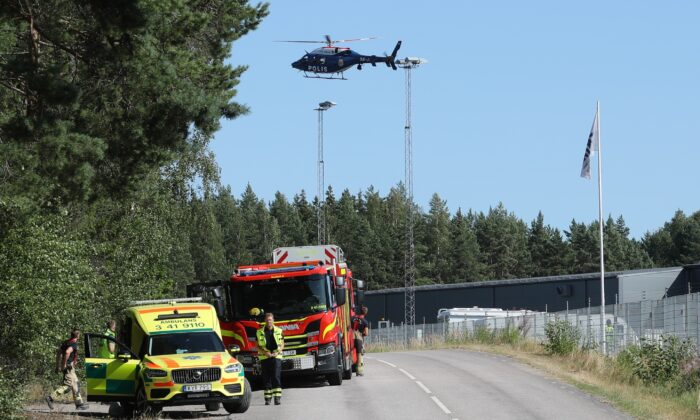 A large police operation with police, fire and rescue service and a police helicopter is underway outside Hallby Prison near Eskilstuna, Sweden, on July 21, 2021. (Per Karlsson/TT via AP)