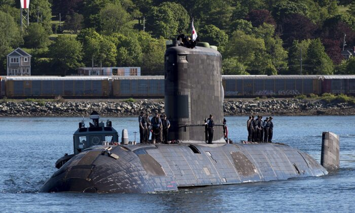 HMCS Windsor, one of Canada's Victoria-class long-range patrol submarines, returns to port in Halifax on June 20, 2018, after completing a five-month deployment in the Euro-Atlantic region to conduct training exercises with other navies and international security partners. (The Canadian Press/Andrew Vaughan)