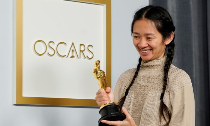 """Director/Producer Chloe Zhao, winner of the award for best picture for """"Nomadland,"""" poses at the press room of the Oscars, in the 93rd Academy Awards in Los Angeles, Calif., on April 25, 2021. (Chris Pizzello/Pool via Reuters)"""