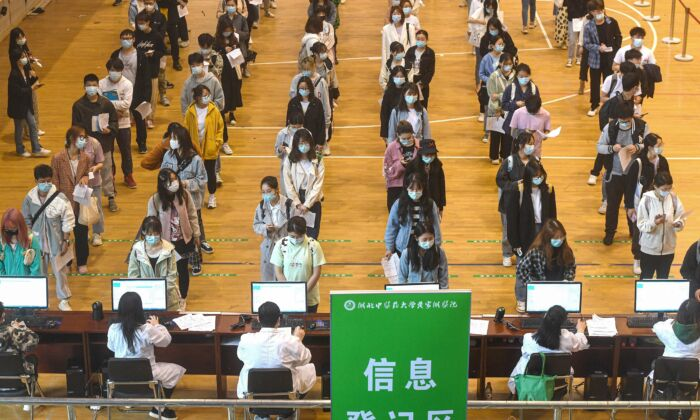 University students queue to receive Covid-19 vaccines at a university in Wuhan, Hubei Province, China, on April 27, 2021. (STR/AFP)