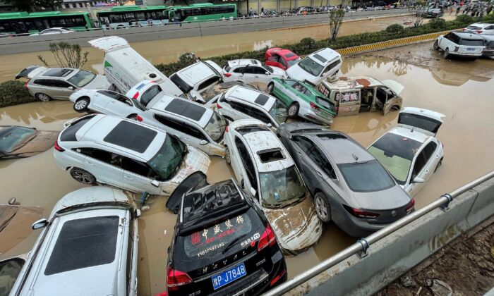 Cars sit in floodwaters after heavy rains hit the city of Zhengzhou in central China's Henan Province on July 21, 2021. (STR/AFP via Getty Images)