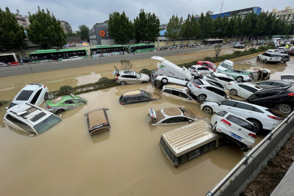 Cars sit in floodwaters after heavy rains
