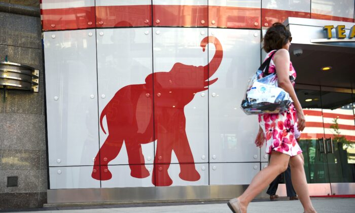 A woman walks past the elephant logo of the Republican Party on the first day of the Republican National Convention in Cleveland, Ohio, on July 18, 2016. (Dominick Reuter/AFP via Getty Images)