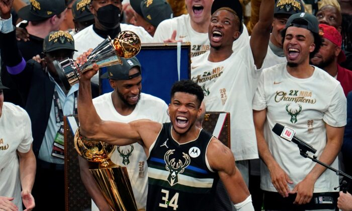 Milwaukee Bucks forward Giannis Antetokounmpo (34) holds the finals MVP trophy after the Bucks defeated the Phoenix Suns in Game 6 of basketball's NBA Finals in Milwaukee, Wis., on July 20, 2021. (Paul Sancya/AP Photo)