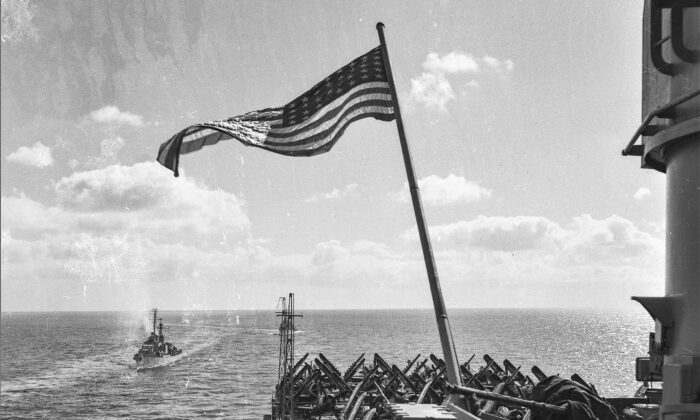 """The USA flag flying at sea on the USS Bon Homme Richard during the Korean War at a time when no airstrikes were happening. """"When airstrikes were active under operations, the United Nations flag was flown,"""" said Navy veteran Arthur Moss. (Courtesy of Arthur Moss)"""