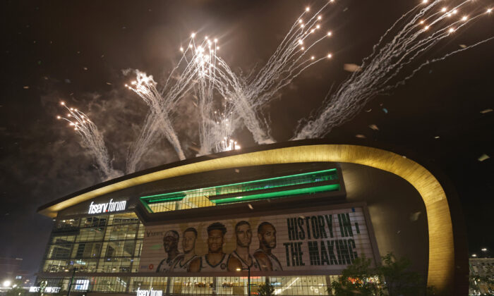 Fireworks explode over fiserv forum after the Milwaukee Bucks defeated the Phoenix Suns in Game 6 of the NBA basketball finals to win the NBA Championship in Milwaukee, Wis.,  on July 20, 2021. (Jeffrey Phelps/AP Photo)