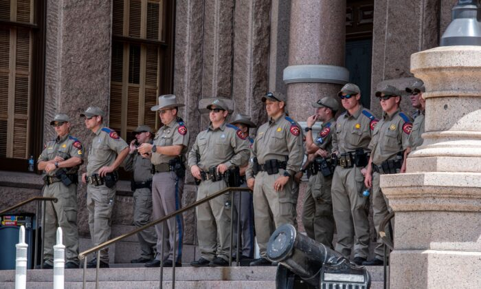 Police look on as a protest takes place outside the Texas state capitol in Austin, Texas, on May 29, 2021. (Sergio Flores/Getty Images)