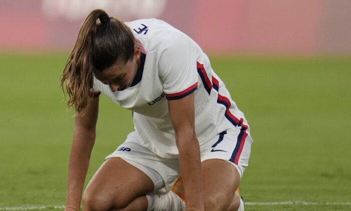 United States' Tobin Heath reacts after losing 0-3 against Sweden during a women's soccer match at the 2020 Summer Olympics, in Tokyo, Japan, on July 21, 2021. (Ricardo Mazalan/AP Photo)