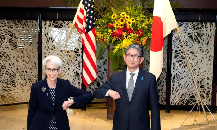 U.S. Deputy Secretary of State Wendy Sherman (L) elbow bumps with Japanese Vice-Minister for Foreign Affairs Takeo Mori (R) prior to their meeting at the Iikura Guesthouse in Tokyo, Japan, on July 20, 2021. (Eugene Hoshiko/AP Photo)