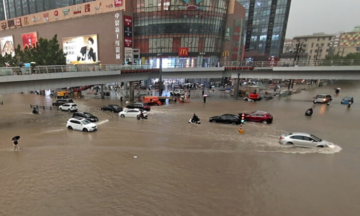 Vehicles are stranded after a heavy downpour in Zhengzhou city, central China's Henan Province on July 20, 2021. (Chinatopix Via AP)