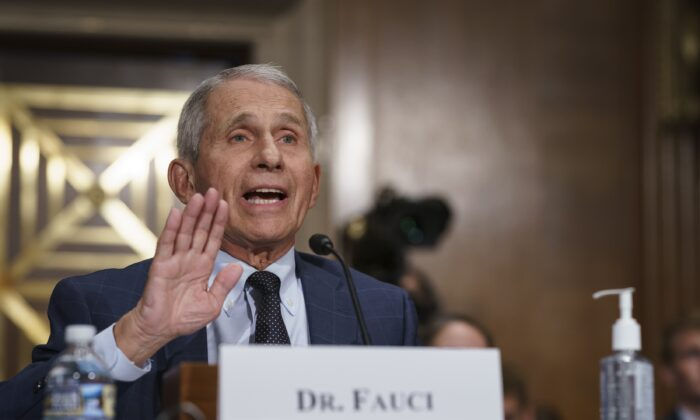 Dr. Anthony Fauci pushes back on statements by Sen. Rand Paul (R-Ky.) during a hearing on Capitol Hill in Washington on July 20, 2021. (J. Scott Applewhite/Pool/AP Photo)
