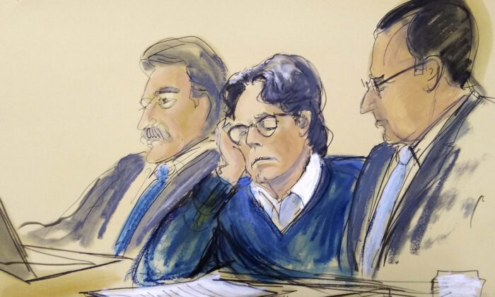 Keith Raniere, center, sits with attorneys Paul DerOhannesian, left, and Marc Agnifilo during closing arguments at Brooklyn federal court in New York, on June 18, 2019. (File courtroom artist's sketch/ Elizabeth Williams via AP)