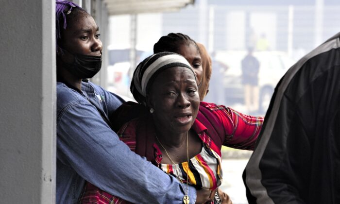 A woman reacts as she doesn't see a relative among the survivors of the sunken cargo ship Niko Ivanka who arrive at John F. Kennedy Memorial Hospital in Monrovia, Liberia, on July 19, 2021. (Carielle Doe/AFP via Getty Images)