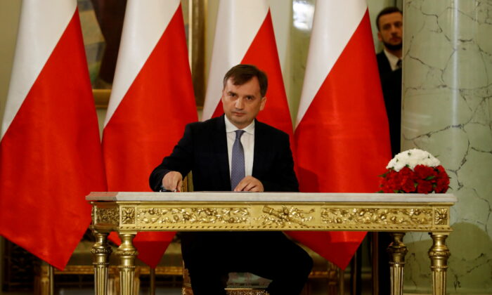 Zbigniew Ziobro signs documents after being designated as Minister of Justice, at the Presidential Palace in Warsaw, Poland, on Nov. 15, 2019. (Kacper Pempel/Reuters)