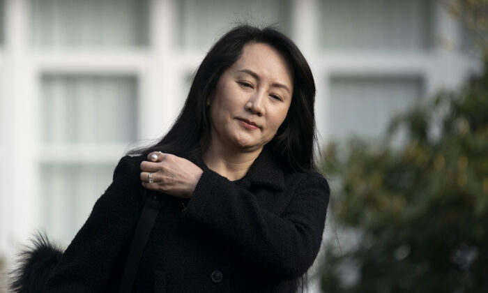 Huawei Chief Financial Officer Meng Wanzhou leaves her home in Vancouver to go to B.C. Supreme Court on March 25, 2021. (The Canadian Press/Jonathan Hayward)