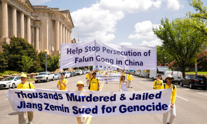 Falun Gong practitioners take part in a parade marking the 22nd anniversary of the start of the Chinese regime's persecution of Falun Gong, in Washington on July 16, 2021. (Samira Bouaou/The Epoch Times)