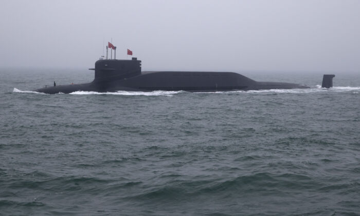 A type 094 Jin-class nuclear submarine Long March 15 of Chinese Navy participates in a naval parade in the sea near Qingdao, in eastern China's Shandong Province on April 23, 2019. (Mark Schiefelbein/AFP via Getty Images)