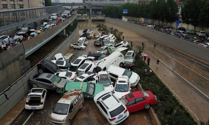 An aerial view shows cars sitting in floodwaters at the entrance of a tunnel after heavy rains hit the city of Zhengzhou, central China's Henan Province on July 22, 2021. (NOEL CELIS/AFP via Getty Images)