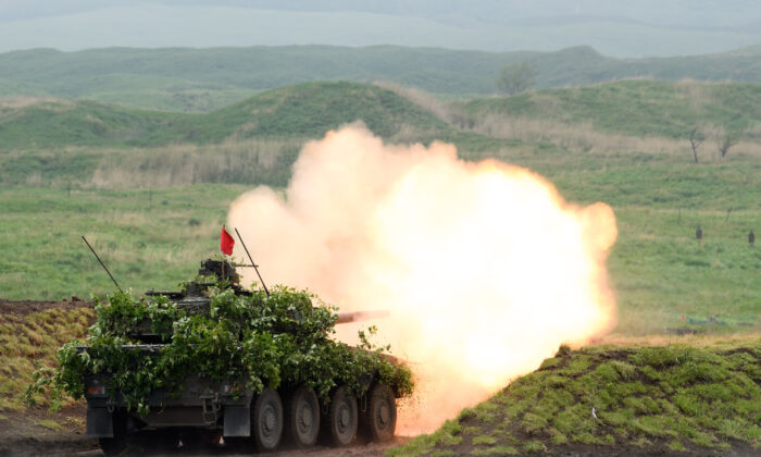 A Type 16 mobile combat vehicle fires ammunition during a live fire exercise at JGSDF's training grounds in the East Fuji Maneuver Area in Gotemba, Shizuoka, Japan, on May 22, 2021. The annual live-fire drill takes place shortly after China's ambassador to Japan criticized the Quad grouping, a security dialogue comprising of the United States, Japan, India and Australia, as representing a 'Cold War mentality' and '100% outdated.' (Akio Kon/Getty Images)
