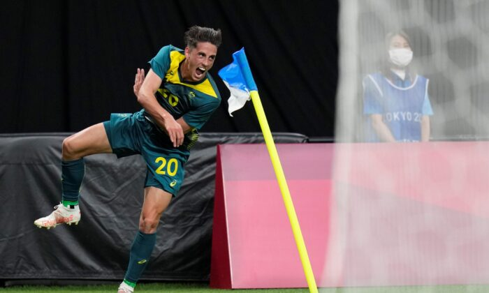Australia's Lachlan Wales celebrates scoring his side's opening goal against Argentina during a men's soccer match at the 2020 Summer Olympics, in Sapporo, Japan, on July 22, 2021. (SIlvia Izquierdo/AP Photo)