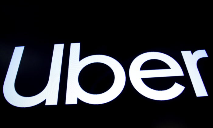 A screen displays the company logo for Uber Technologies Inc. on the day of its IPO at the New York Stock Exchange (NYSE) in New York, on May 10, 2019. (Brendan McDermid/File Photo/Reuters)