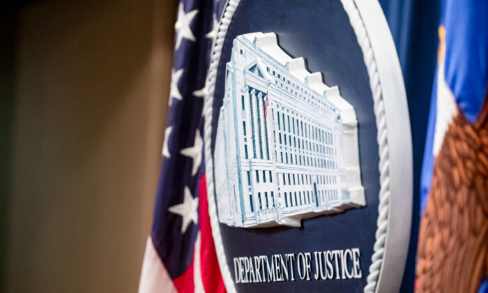 The U.S. Department of Justice seal on the stage at the U.S. Department of Justice in Washington, on Dec. 5, 2019. (Samuel Corum/Getty Images)