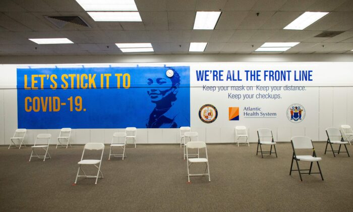 A sign is displayed in the registration area of a COVID-19 vaccination site at the Townsquare Mall in Rockaway, N.J., on Jan. 8, 2021. (Kena Betancur/AFP via Getty Images)