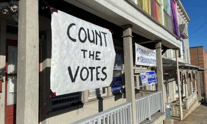 A sign is seen on the porch of the Democratic Party's Fulton County headquarters on Election Day in McConnellsburg, Pennsylvania, on Nov. 3, 2020. (Nathan Layne/Reuters)