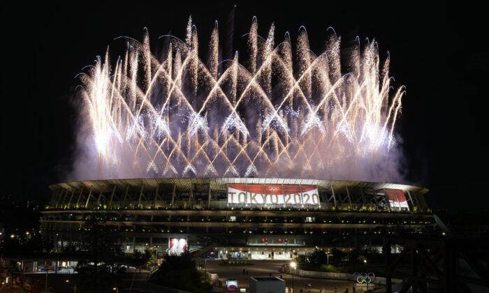 Fireworks illuminate over the National Stadium during the opening ceremony of the 2020 Summer Olympics in Tokyo, Japan, on July 23, 2021. (Shuji Kajiyama/AP Photo)