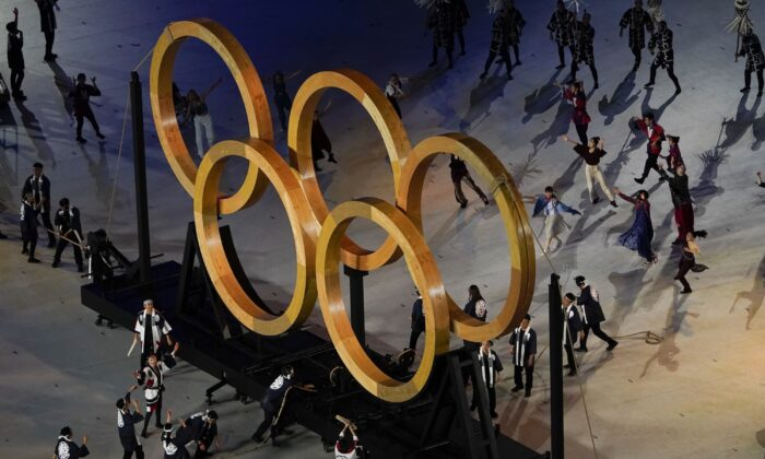 Actors perform during the opening ceremony at the Olympic Stadium at the 2020 Summer Olympics in Tokyo, Japan, on July 23, 2021. (Morry Gash/AP Photo)